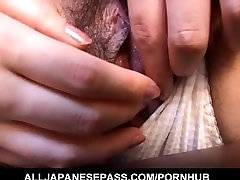 Mai does handjob after exposing tits and having cunt aroused