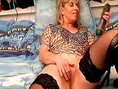 beautiful mature playing with two cucumber in webcam