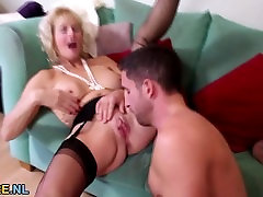 Big boobed blonde mature bouncing on a young cock