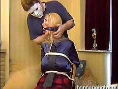 Petra chair bound and scarf gagged