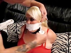 Bound and gagged in leopard print leggins.