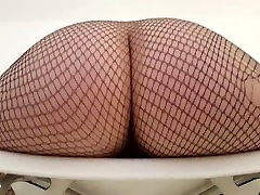 Hot Metal Babe wears stockings and hangs her big ass over a chair!