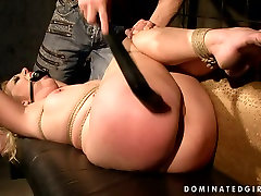 Submissive gagged blondie gets tied up and treated in a tough BDSM way