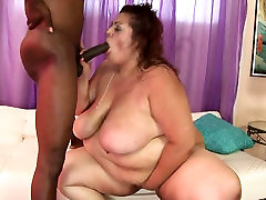 BBW slut gives blowjob to her black man and gets her pussy fucked hard