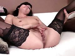 Lusty brunette chick in black stockings Dakota exposes her muff