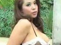 Hot Delicious Busty Asian Chick Dancing In Front of Gate