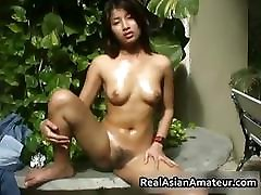 Naked Asian cutie drills her pussy part6