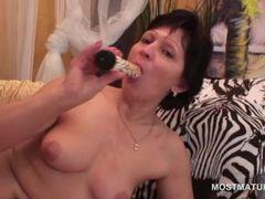 Brunette slim mature masturbating with vibrator and fingers