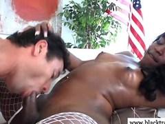 Ebony TS shemale gets dicksucked