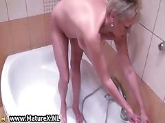 Fat mature lady takes a hot shower part2