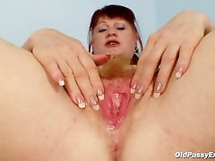 Mature Olga has her redhead hairy pussy gyno