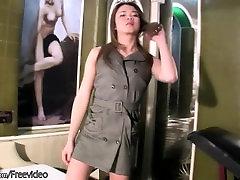 Cute brunette ladyboy is teasing her hairy dick on camera