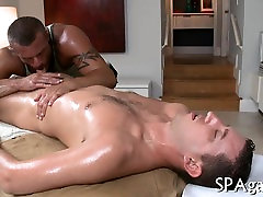 Gay masseur is giving stud a wild oral-service session