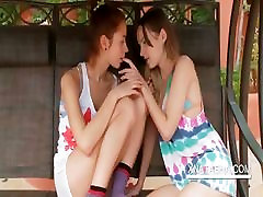 Lesbo nymphos making out in a swing