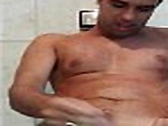 Shaved Latino masturbating by the mirror