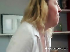 Blonde horny MILF rubs pussy on a chair