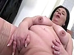 Chubby brunette mature toying her pussy