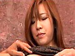 Japanese chick sucks two schlongs