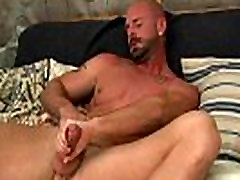 Older muscular hunk with tattoos jerks off his hard dick