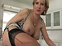 Mature lingerie slut flirtatious posing for the camera
