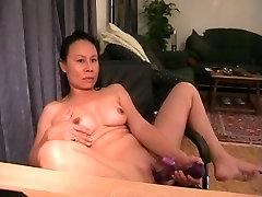 Mature Asian in a masturbation video