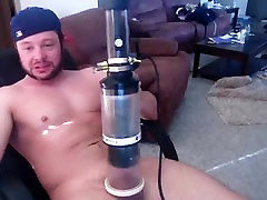 Handsome male is having fun in the bedroom and memorializing himself on webcam
