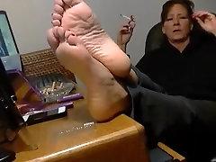 Smoking mature show her feet