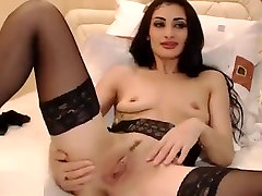 Brunette in black stockings Aspasia masturbating on webcam