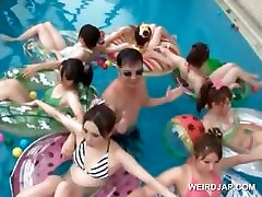 Cute asian teens get cunt licked in a pool group sex