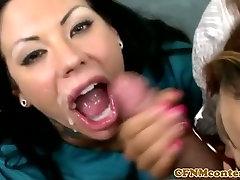 Femdoms jerking cock in trio before facial