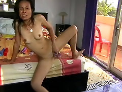 Ugly busty Asian wife plays with her toy