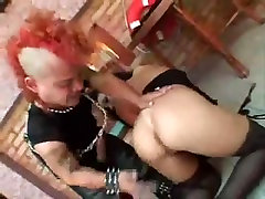 Hot chick gets some anal from a midget with a mohawk