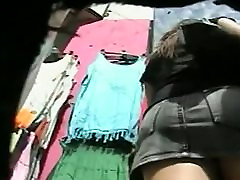 Sexy booties swaying in front of hidden camera up skirt shot