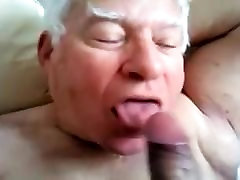 A gray-haired old man sucking another man&039;s cock