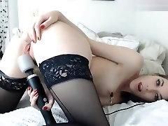 Pretty woman in black stockings Audrey, fucks herself