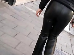 asian girl walking sexy in tight leather pants on street