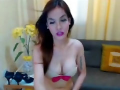 Shemale with Perky Tits Playfully Strokes Dick