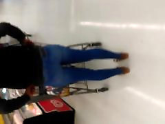 Ebony teen pulling up tight jeans at walmart