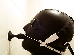Plug suck with headgear braces in latex