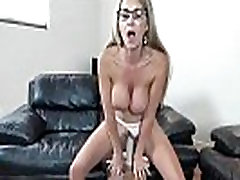 Big breasted mother riding on toy
