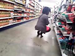 Ebony milf squatting