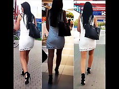 58 Girl with sexy legs in high heels and white minidress