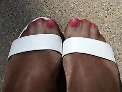 Rubbing Shiny Pantyhose Legs Outdoors