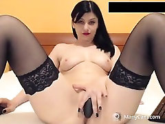 Sexy brunette MILF in black stockings