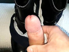 Using her boots and used panties to cum on