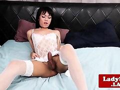 Sensual lingeried ladyboy solo pulling cock