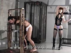 The Japanese Domina hits a detained slave with a whip