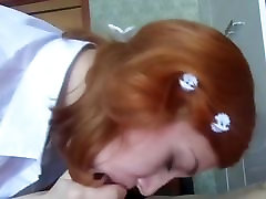Horny redhead in school uniform gives a blowjob