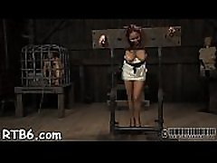 Restrained beauty is hoisted up for her hot punishment