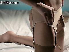 sleek babe in nylon jerking off strapon